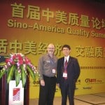 Photo Fred Schenkelberg and Feng-bin Sun on stage of Sino-American Quality Summit, in Guangdong, China