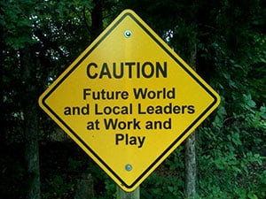 Caution Future World and Local Leaders at Work and Play